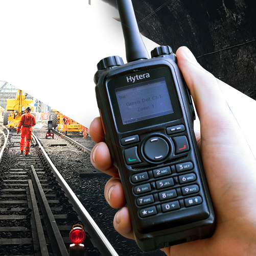 Image of a two way radio being used by a rail contractor