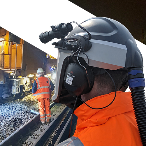 Rail industry engineer with respirator and protective cape